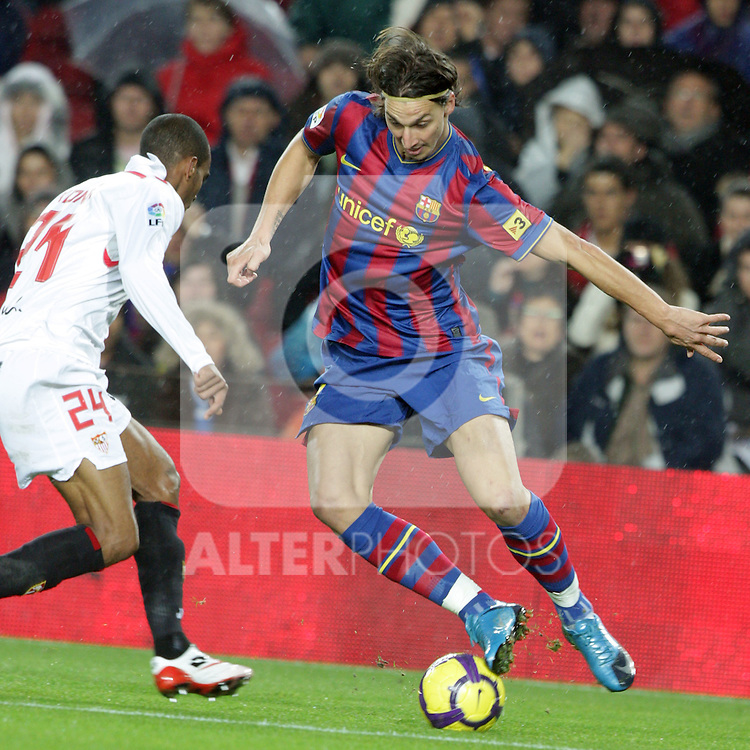 Football Season 2009-2010. Barcelona's player Zlatan Ibrahimovic (R) and Sevilla's  Konko (L) during their spanish liga soccer match at Camp Nou stadium in Barcelona. January 16, 2010.