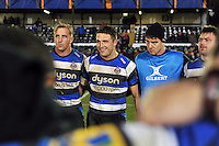 Dominic Day, Sam Burgess and Ollie Devoto look on in a post-match huddle. European Rugby Champions Cup match, between Bath Rugby and Montpellier on December 12, 2014 at the Recreation Ground in Bath, England. Photo by: Patrick Khachfe / Onside Images