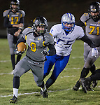 Galena running back #8 Jake Berger is chased by McQueen defender #55 Hunter Wagner during their Northern Division I playoff football game played on Friday night, November 6, 2015 at Galena High School in Reno, Nevada.