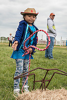 NWA Democrat-Gazette/ANTHONY REYES &bull; @NWATONYR<br /> Haydee Ramirez Araujo, 7, first grader at George Elemenatry School, lassos a straw cow Thursday, April 23, 2015 at the annual Stick Horse Rodeo at Parsons Stadium in Springdale. The students participated in a number of activities with a rodeo theme including roping, stick horse riding, music and riding a bucking barrel.