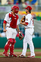 Charles Cutler (37) of the Springfield Cardinals talks with Scott Schneider (29) of the Springfield Cardinals on the mound during a game against the Tulsa Drillers at Hammons Field on July 18, 2011 in Springfield, Missouri. Tulsa defeated Springfield 13-8. (David Welker / Four Seam Images)