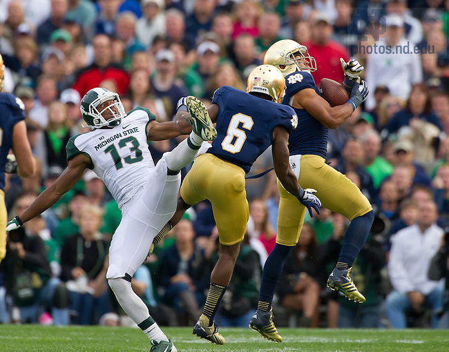 Sept. 21, 2013; Matthias Farley (41) intercepts a pass against Michigan State.<br /> <br /> Photo by Matt Cashore