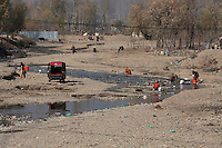 People use a nearly dried up river to do washing of clothes. Kashmir, India. © Fredrik Naumann/Felix Features
