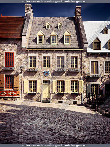 Historic architecture of Galerie Place Royale building in Royal Square on a bright sunny day in Old Quebec City. Quebec, Canada. Place Royale, Ville de Québec.