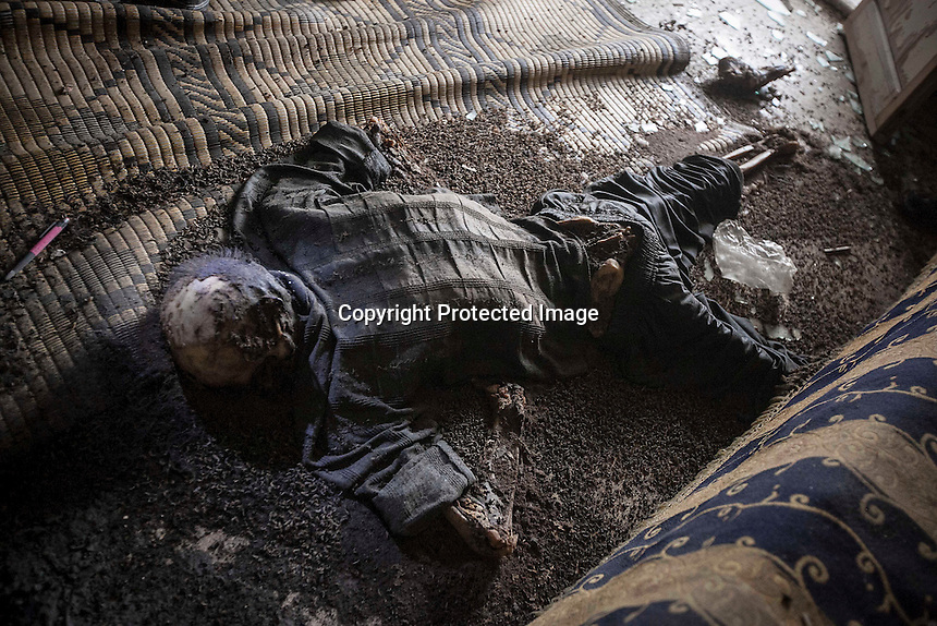 In this Monday, Dec. 10, 2012 photo, a teenager's dead body allegedly executed and abandoned lies inside a residential house after it was discovered by Syrian rebels when they carried out a raid in the battlefield of Aleppo, Syria. (AP Photo/Narciso Contreras)