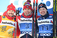 1st January 2020, Toblach, South Tyrol , Italy;  Winner Alexander Bolshunov, second placed Sergey Ustiugov of Russia and third placed Iivo Niskanen of Finland pose on podium after mens cross country skiing 15 km classic style pursuit at the FIS Tour de Ski event in Toblach, Italy on January 1, 2020.