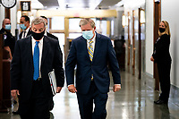 """United States Senator Dick Durbin (Democrat of Illinois), left, and US Senator Lindsey Graham (Republican of South  Carolina), Chairman, US Senate Judiciary Committee, right, walk to a US Senate Judiciary Committee Hearing """"to examine COVID-19 fraud, focusing on law enforcement's response to those exploiting the pandemic"""" on Capitol Hill in Washington, DC on June 9, 2020.<br /> Credit: Erin Schaff / Pool via CNP/AdMedia"""