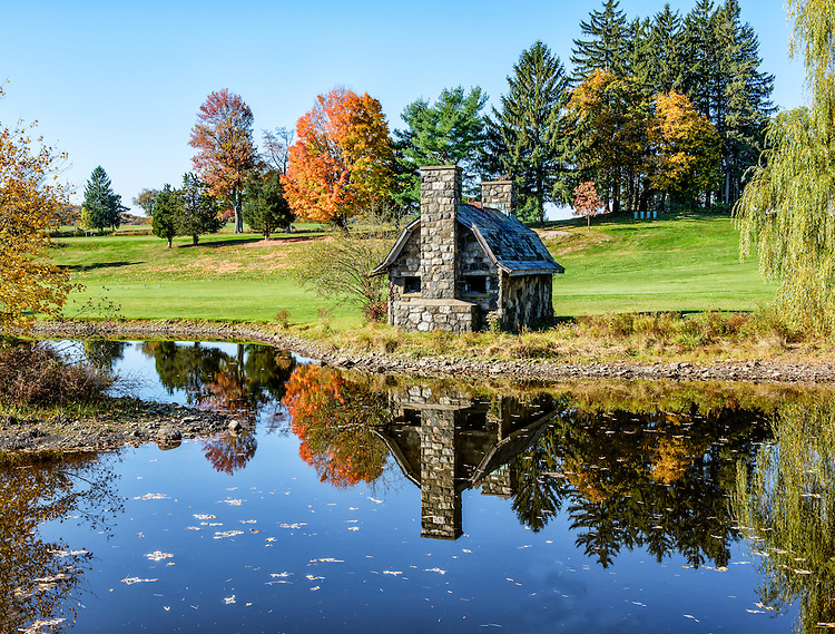 Reflections in a pond in autumn, in Garrison, New York