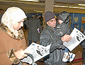 New Carrollton, MD - January 29, 2005 -- Najlaa Abdul-Karim, left, and Abdul Rahim, center, look over their sample ballots before voting in the Iraqi elections in New Carrollton, Maryland on January 29, 2005.  Their nephew, Ali Al-Jeburi, right watches from his uncle's arms. from Abdul's.Credit: Ron Sachs / CNP..(RESTRICTION: NO New York or New Jersey Newspapers or newspapers within a 75 mile radius of New York City)
