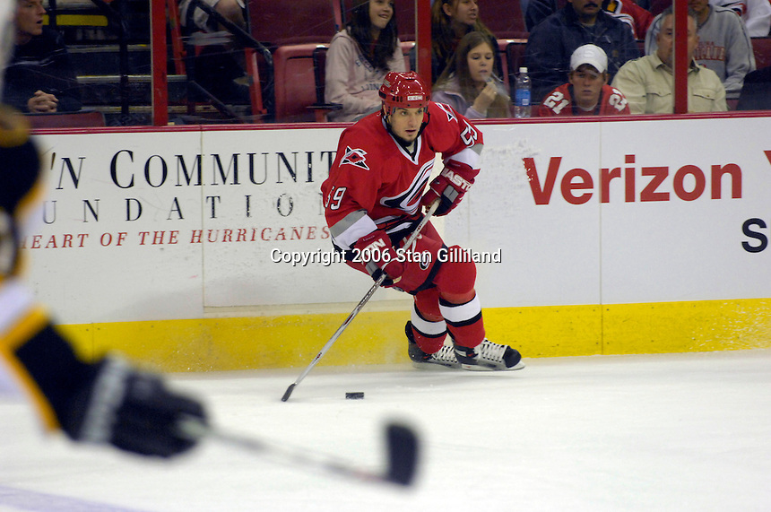 Carolina Hurricanes' Chad LaRose looks for a teammate during an NHL hockey game against the Boston Bruins Saturday, Dec. 2, 2006 in Raleigh, N.C. Carolina won 5-2.<br />