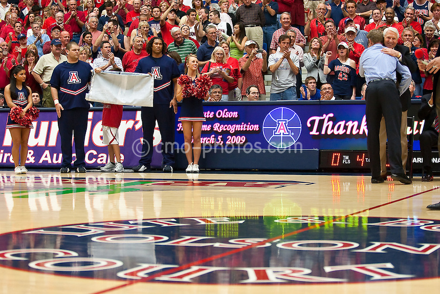 Mar 5, 2009; Tucson, AZ, USA; Former Arizona WIldcats head coach Lute Olson and former player, and current Phoenix Suns general manager, Steve Kerr hug while standing on Lute and Bobbi Olson court during a ceremony honoring Olson during halftime of a game against the California Golden Bears at the McKale Center.  Cal defeated Arizona 83-77.