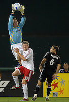 DC United goalkeeper Troy Perkins (1)  goes up to get possession of the ball while covered by New York Red Bulls John Wolyniec (15). DC United defeated the New York Red Bulls 3-1, at RFK Stadium in Washington DC, Thursday August  22, 2007.