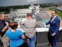 LOUISVILLE, KY - MAY 06: Kentucky Governor Matt Bevin shares a laugh with members of the Louisville Police Department from the rooftop of Churchill Downs before the American Turf Stakes on Kentucky Derby Day on May 6, 2017 in Louisville, Kentucky. (Photo by Jon Durr/Eclipse Sportswire/Getty Images)