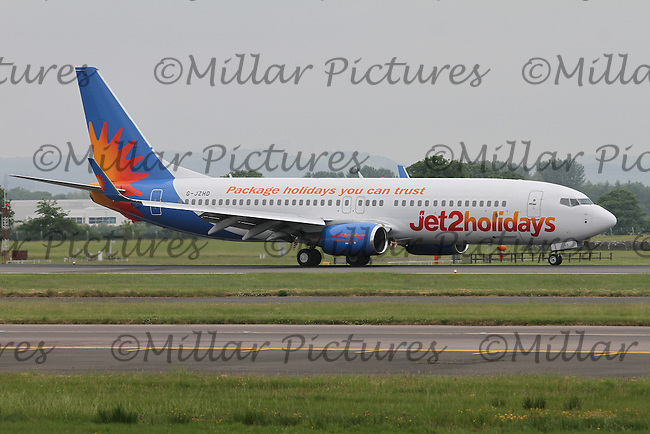 A Jet2 Boeing 737-808 Registration G-JZHD in Holidays livery at Glasgow Airport on 4.6.16 arriving from Manchester International Airport.