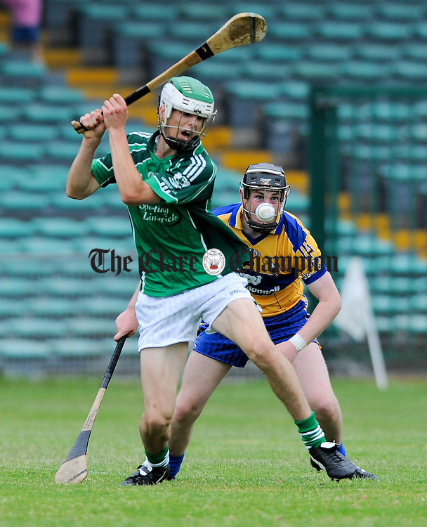 Dan Morrissey of Limerick in action against Enda Boyce of Clare during their Munster minor championship semi-final at The Gaelic Grounds. Photograph by John Kelly.