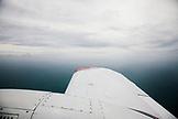 EXUMA, Bahamas. A view of the Atlantic Ocean from a prop plane enroute towards the Exuma Islands.