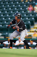 Jupiter Hammerheads outfielder Yefri Perez (12) squares to bunt during a game against Bradenton Marauders on August 4, 2015 at McKechnie Field in Bradenton, Florida.  Jupiter defeated Bradenton 9-3.  (Mike Janes/Four Seam Images)