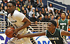 KC Ndefo #4 of Elmont, left, gets pressured byTaliq Abdul-Rahim #1 of Valley Stream North during the Nassau County varsity boys basketball Class A semifinals at Hofstra University in Hempstead, NY on Wednesday, March 1, 2017. Elmont won by a score of 67-50.