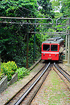 "Rio de Janeiro, Brazil: Famous train ""Trem do Corcovado"" travelling up to the mountain top of Corcovado with it's christ statue Christo Redentor. The 3.3km long electric cog wheel railway between Cosme Velho Station and the mountain top was opened in 1884 and runs through the rain forest with some breathtaking views onto Rio. --- No releases available."