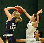 JANUARY 6, 2015 -- Dakota Barrie #32 of Black Hills State blocks Megan Rohrer #33 of South Dakota Mines during their college women's basketball game Tuesday evening at the Donald E. Young Center in Spearfish, S.D. At right is Mackenzie Kenney #40 of South Dakota Mines.  (Photo by Dick Carlson/Inertia)