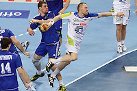 12.01.2013 Barcelona, Spain. IHF men's world championship, Quarter-Final. Picture show Miha Zvizej   in action during game between Russia vs Slovenia at Palau ST Jordi
