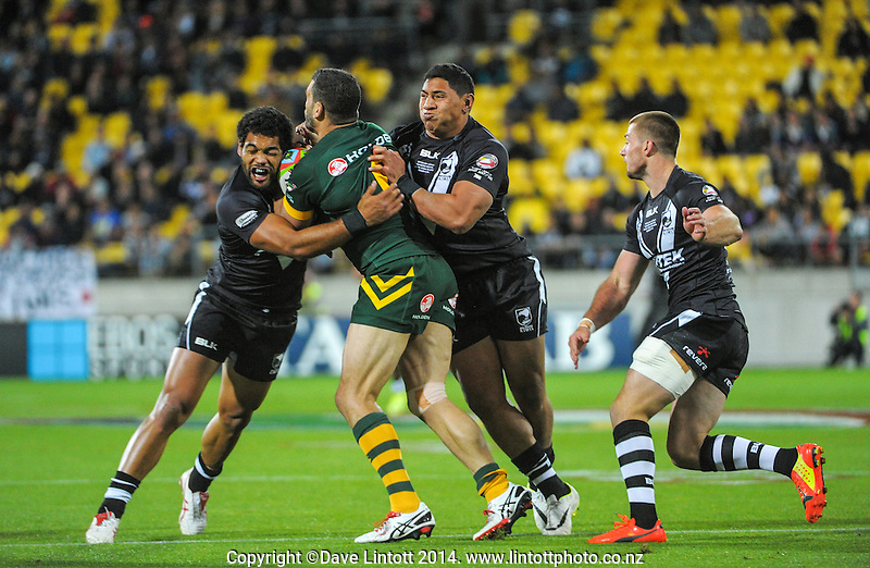 Adam Blair (left) and Jason Taumalolo stop Greg Inglis during the Four Nations rugby league final between the NZ Kiwis and Australia Kangaroos at Westpac Stadium, Wellington on Saturday, 15 November 2014. Photo: Dave Lintott / lintottphoto.co.nz