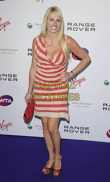 Nancy Sorrell  .The WTA Tour Pre-Wimbledon Party at The Roof Gardens, Kensington, London, England, UK..16th June 2011.full length red cream white beige striped dress hand on hip clutch bag open toe shoes .CAP/CAN.©Can Nguyen/Capital Pictures.