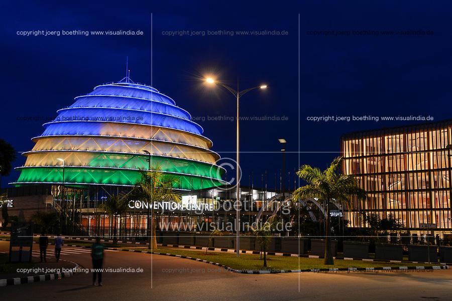 RWANDA, Kigali, illuminated Convention Center  / RUANDA, Kigali, Convention Center, Kongresszentrum mit abendliche Beleuchtung in den Farben der Nationalflagge, rechts Radisson Blu Hotel