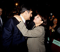 "Montreal (Qc) CANADA - File Photo - Jan 1996 -<br /> <br /> Lucien Bouchard,  Leader Parti Quebecois (from Jan 29, 1996 to March 2, 2001). seen in a file photo with Francine Simard<br /> <br /> After the Yes side lost the 1995 referendum, Parizeau resigned as Quebec premier. Bouchard resigned his seat in Parliament in 1996, and became the leader of the Parti Qu»b»cois and premier of Quebec.<br /> <br /> On the matter of sovereignty, while in office, he stated that no new referendum would be held, at least for the time being. A main concern of the Bouchard government, considered part of the necessary conditions gagnantes (""winning conditions"" for the feasibility of a new referendum on sovereignty), was economic recovery through the achievement of ""zero deficit"". Long-term Keynesian policies resulting from the ""Quebec model"", developed by both PQ governments in the past and the previous Liberal government had left a substantial deficit in the provincial budget.<br /> <br /> Bouchard retired from politics in 2001, and was replaced as Quebec premier by Bernard Landry."