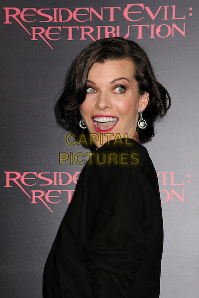 "Milla Jovovich.""Resident Evil: Retribution"" Los Angeles Premiere held at Regal Cinemas L.A. Live, Los Angeles, California, USA..September 12th, 2012.half length black mouth open side .CAP/ADM/BP.©Byron Purvis/AdMedia/Capital Pictures."