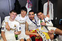 Pictured L-R: Swansea players Ben Davies, Ki Sung Yueng, Chico Flores and Angfel Rangel in the changing room after the game. Sunday 24 February 2013<br /> Re: Capital One Cup football final, Swansea v Bradford at the Wembley Stadium in London.