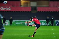 Tyler Bleyendaal of Munster kicks a penalty during the Heineken Champions Cup Round 1 match between the Ospreys and Munster at the Liberty Stadium in Swansea, Wales, UK. Saturday 16th November 2019