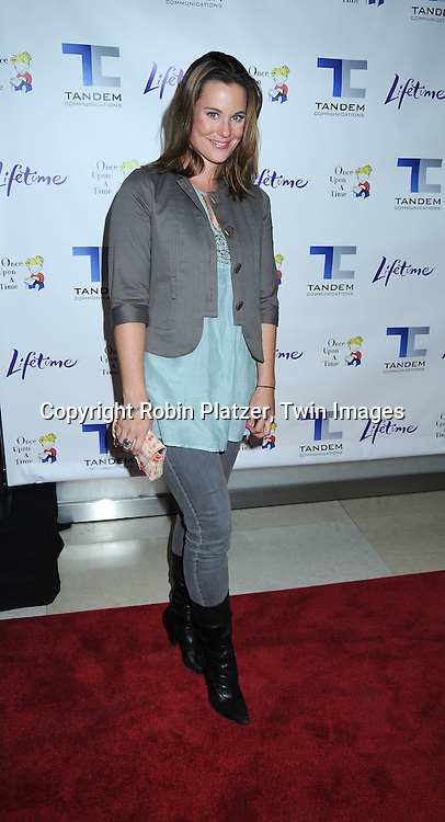 """actress Ashley Williams posing for photographers at The Lifetime Television screening of Patricia Cornwell's novel """"The Front"""" starring .Daniel Sunjata, Andie MacDowell and Ashley Williams at The Hearst Tower on April 7, 2010."""