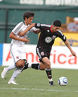 Pablo Hernandez #21 of D.C. United holds off Marlon Pack #36 of Portsmouth FC during an international friendly match at RFK Stadium on July 24 2010, in Washington D.C. United won 4-0.