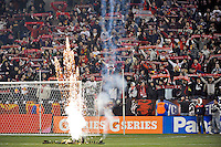 Fireworks go off as \R supporters hold up their scarves. The New York Red Bulls defeated the Seattle Sounders 1-0 during a Major League Soccer (MLS) match at Red Bull Arena in Harrison, NJ, on March 19, 2011.