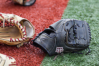 Texas A&M Aggies baseball gloves on April 24, 2015 at Alex Box Stadium in Baton Rouge, Louisiana. LSU defeated Texas A&M 9-6. (Andrew Woolley/Four Seam Images)