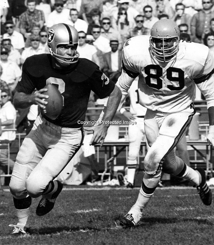 Raider QB Daryle Lamonica chased by Bengle lineman..Photo by Ron Riesterer