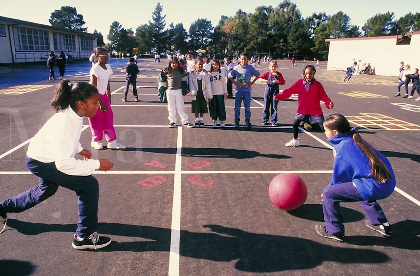 Recess at Carl Munck Elementary School. Playground activities. Playing Foursquare. Oakland, California.