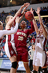 SIOUX FALLS, SD - MARCH 5:  Ciera Morgan #20 of Denver takes a shot against a pair of South Dakota defenders including Allison Arens #10 of South Dakota during the 2016 Summit League Tournament. (Photo by Dave Eggen/Inertia)