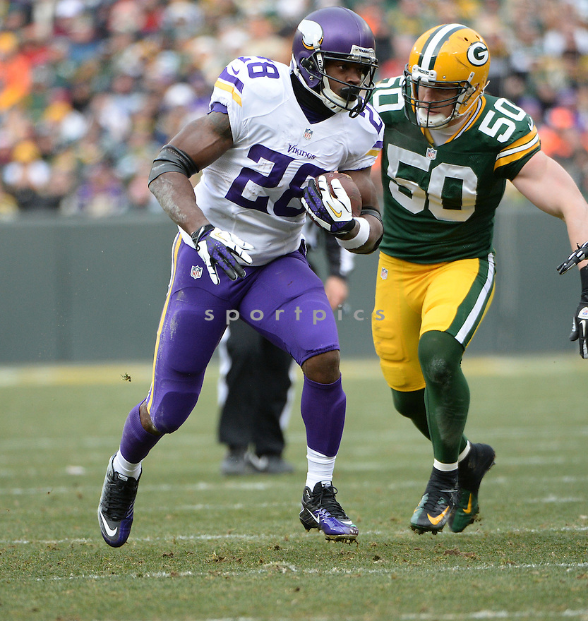 Minnesota Vikings Adrian Peterson (28) during a game against the Green Bay Packers on November 24, 2013 at Lambeau Field in Green Bay, WI. The game ended in a tie, 26-26.