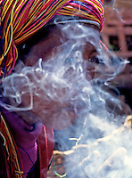 Hill tribe,Smoking the traditional Cigars Myanmar, Burma,