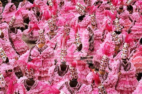 Rio de Janeiro, Brazil. Mangueira samba school carnival parade; ala das Bahianas in pink feathers and white.