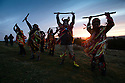 01/05/16<br /> <br /> At the break of dawn, with the weather forecast promising a much warmer week ahead, the sun rises on a group of Border Morris Dancers celebrating May Day with a traditional performance, Dance up the Dawn, on top of Windgather Rocks, a gritstone crag near Whaley Bridge on the Derbyshire - Cheshire Peak District border.<br /> <br /> The Powderkegs, a group of 16 dancers, paint their faces black, wear rag jackets and jingle bells on their legs.<br /> <br /> The group formed in 2001, and took their name from local gunpowder mills.<br /> <br /> Their traditional style of dance is noisy, colourful and explosive.<br /> <br /> The dancers and musicians, both men and women, wear red, yellow, gold and orange rag jackets and trousers to signify fire and explosions. <br /> <br /> A selection of sparkly materials adds to the  flame effect when they dance.<br /> <br /> It is believed that the Border Morris Dancers&rsquo; costume dates back to the time of tied workers, in the early 19th century, when extra money could be made at fairs dancing and playing music. <br /> <br /> The workers would be evicted if caught by the squire so they used materials close to hand - rags and coal dust to disguise themselves. <br /> <br /> All Rights Reserved: F Stop Press Ltd. +44(0)1335 418365   www.fstoppress.com.