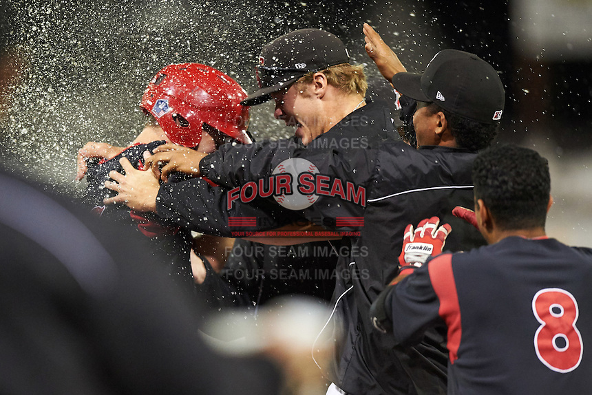 Batavia Muckdogs Blake Anderson (with helmet) and pitcher Steven Farnworth (right) celebrate after a game winning walk off hit during a game against the Williamsport Crosscutters on August 27, 2015 at Dwyer Stadium in Batavia, New York.  Batavia defeated Williamsport 3-2.  (Mike Janes/Four Seam Images)