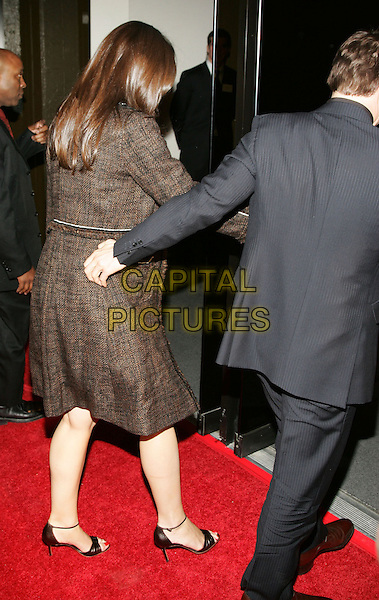 TOM CRUISE & KATIE HOLMES.Sighted in Tribeca, New York, NY..December 14th, 2005.Photo: Jackson Lee/Admedia/Capital Pictures.Ref: JL/ADM.full length celebrity couple brown coat back behind rear.www.capitalpictures.com.sales@capitalpictures.com.© Capital Pictures.