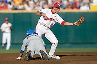 South Carolina 2B Scott Wingo shows the umpire the ball following a force out early in Game Two of the NCAA Division One Men's College World Series Finals on June 29th, 2010 at Johnny Rosenblatt Stadium in Omaha, Nebraska.  (Photo by Andrew Woolley / Four Seam Images)