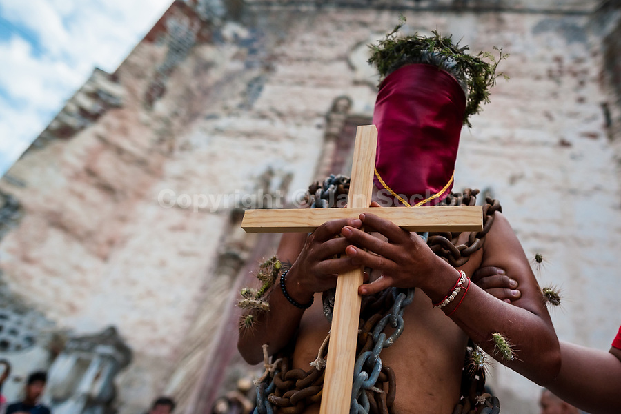 A chained penitent, wearing cactus spines stuck to his body and holding a wooden cross, takes part in the Holy week procession in Atlixco, Mexico, 30 March 2018. Every year on Good Friday, dozens of anonymous men of all ages voluntarily undergo pain and suffering during the religious procession of the 'Engrillados' (the Shackled ones) in Puebla state, central Mexico. Wearing heavy chains on their shoulders covered with prickling cacti while being burned by the hot midday sun, they recall Jesus Christ's death by crucifixion and demonstrate their religiosity and faith.