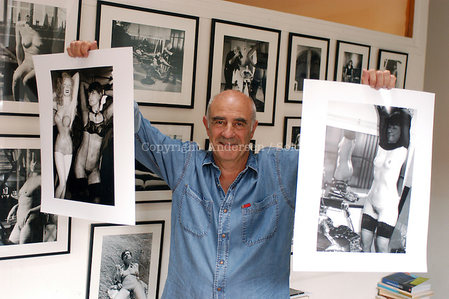 Jacques Henric, with his pictures of Catherine Millet in 2004.
