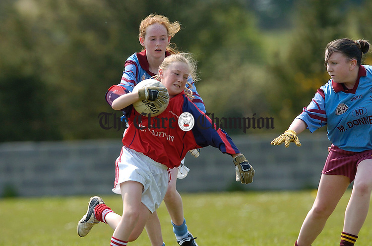 Marie Rynne of Spanish Point gives chase to Rachel O Brien of St Caimins  during the Schools Ladies Football blitz final in Inagh. Photograph by John Kelly.