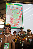 "Altamira, Brazil. ""Xingu Vivo Para Sempre"" protest meeting about the proposed Belo Monte hydroeletric dam and other dams on the Xingu river and its tributaries. Kalapalo indians infront of a map of the Xingu area."